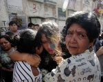 Friends and family attend the funeral of a victim of the fire at the Virgen de Asuncion children shelter, at the cemetery in Guatemala City.