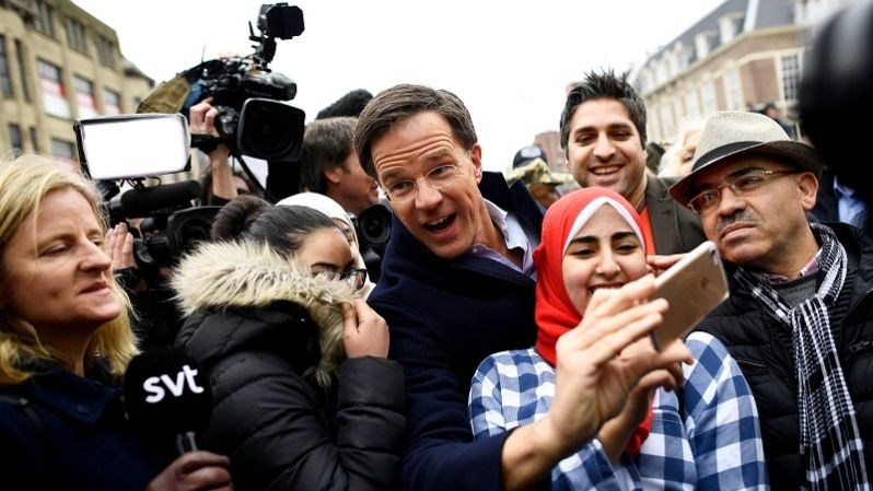 Dutch Prime Minister Mark Rutte of the VVD Liberal party greets supporters during campaigning in The Hague, Netherlands March 14, 2017.