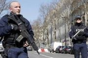 Police outside the International Monetary Fund offices where an envelope exploded in Paris, France, March 16, 2017.