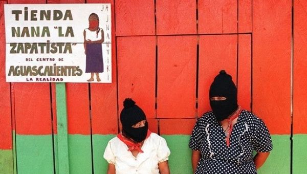 Zapatista women outside of a militant-run store in Chiapas