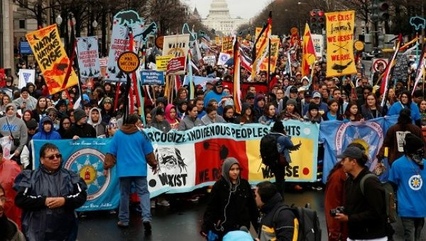 Indigenous leaders participate in a protest march and rally in opposition to the Dakota Access and Keystone XL pipelines.
