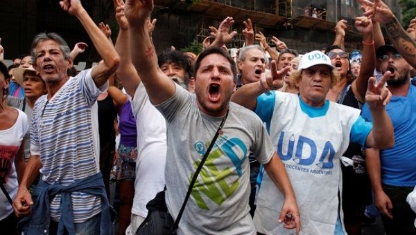 Protesters yells slogans during a march of Argentina