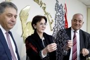 Palestinian Ambassador to Lebanon stands next to U.N. Under-Secretary General Khalaf while she holds a gift after a news conference announcing her resignation.