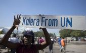 A protester holds up a sign during a demonstration against the U.N. mission in downtown Port-au-Prince, Nov. 18, 2010.