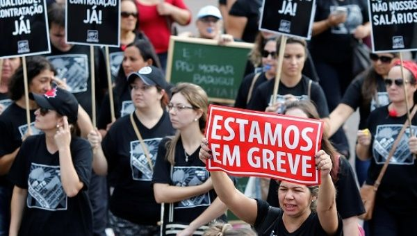 Demonstrators protest during a strike against Brazilian Social Welfare reform project, in Curitiba.