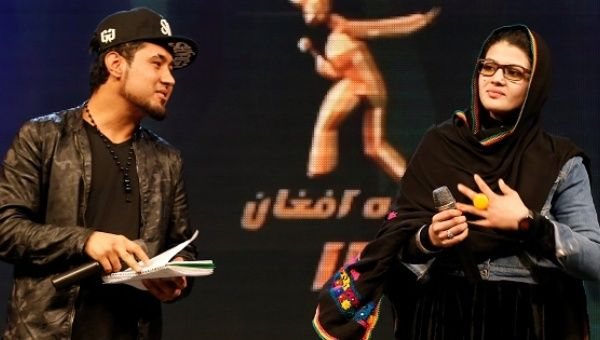 "Zulala Hashimi (R) and Sayed Jamal Mubarez (L), finalists of the music contest ""Afghan Star,"" rehearse for the show in Kabul, Afghanistan, March 19, 2017."