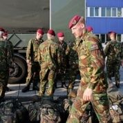 Dutch soldiers, part of the flash power military unit, a rapid intervention force which also includes Germany and Norway, prepare for an international military alert exercise at the NATO airbase.