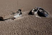 Fishing boats are shown on the dried Poopo lake bed in the Oruro Department, south of La Paz, Bolivia, on Dec. 17, 2015.