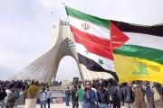 A man carries a giant flag made of flags of Iran, Palestine, Syria and Hezbollah, while marking the Islamic Revolution anniversary, Tehran, Feb. 11, 2016.