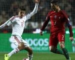 Hungary's Adam Nagy in action with Portugal's Cristiano Ronaldo