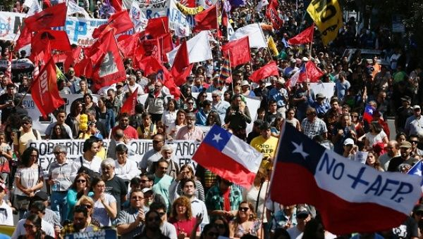 Demonstrators take part in a protest against the pension system in Valparaiso, Chile.