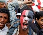 Supporters of the Houthi movement and Yemen's former president Ali Abdullah Saleh shout slogans as they attend a rally to mark two years of the Saudi's war.