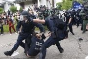 Police scuffle with a demonstrator as they try to apprehend him during a rally in Baton Rouge, Louisiana, U.S.