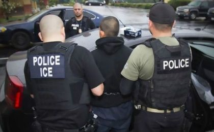 Reportedly an occupant of the house is wanted on weapons charges but ICE decline confirm.