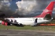 Peruvian Airliner plane on fire after landing.