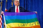 Donald Trump holds up a rainbow flag with ''LGBTs for Trump'' written on it at a campaign rally in Greeley, Colorado, Oct. 2016.