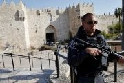 An Israeli policeman stands guard near the scene at Damascus Gate where a Palestinian woman was shot dead in Jerusalem, March 29, 2017.