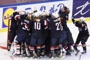Team USA players react on winning the 2015 Ice Hockey Women's World Championship gold medal match between USA and Canada.
