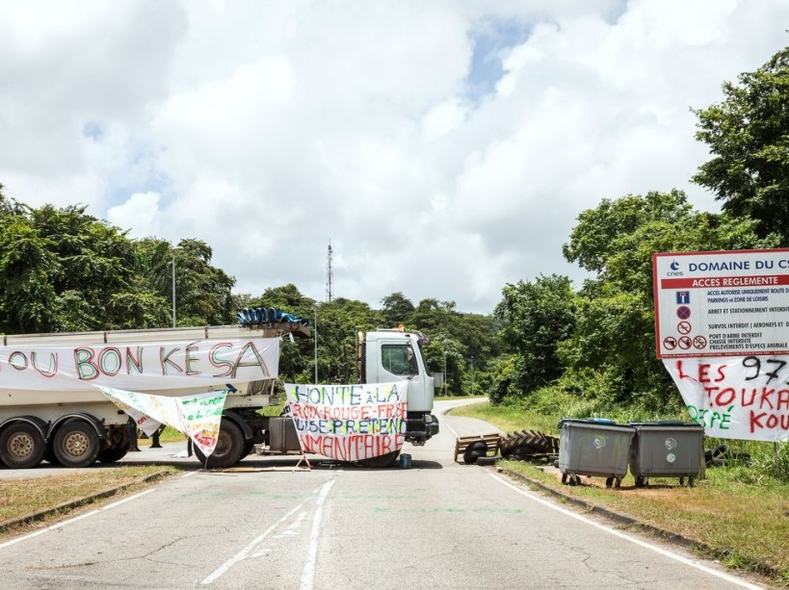 In the Kourou commune, protesters set up road blocks to stop cars passing into the center.
