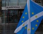 A Scottish Saltire flag flies outside the Scottish Parliament following suspension of the referendum debate in Edinburgh, Scotland, Britain March 22, 2017.