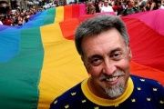 Gilbert Baker, creator of the rainbow flag, leading the Stockholm Pride Parade. Aug. 3, 2003