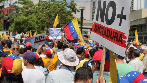 "Opposition supporters echo their leaders declaration that the Venezuelan government is now ""officially a dictatorship."""
