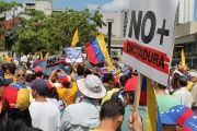 Opposition supporters echo their leaders declaration that the Venezuelan government is now