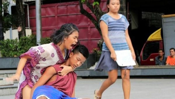 "Filipino theatre artists perform a ""La Pieta"" scene during a short musical about the killings under the Philippine government"