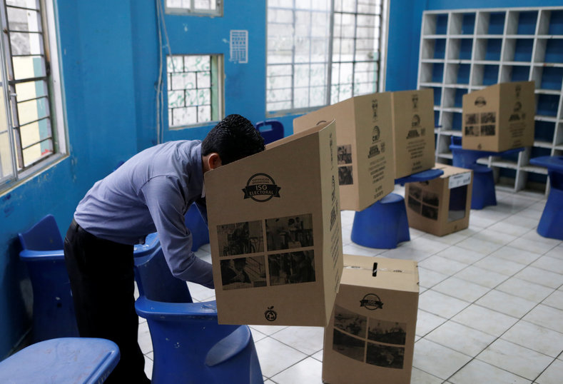 A man casts his vote in a school used as a polling station during the presidential election, in Guayaquil.