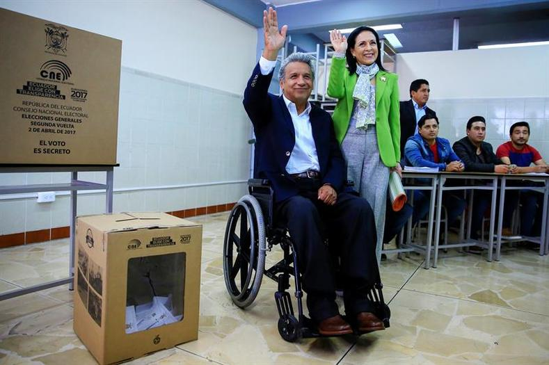 Lenin Moreno and his wife Rocio Gonzalez wave after Moreno casted his vote during the presidential election in Quito.