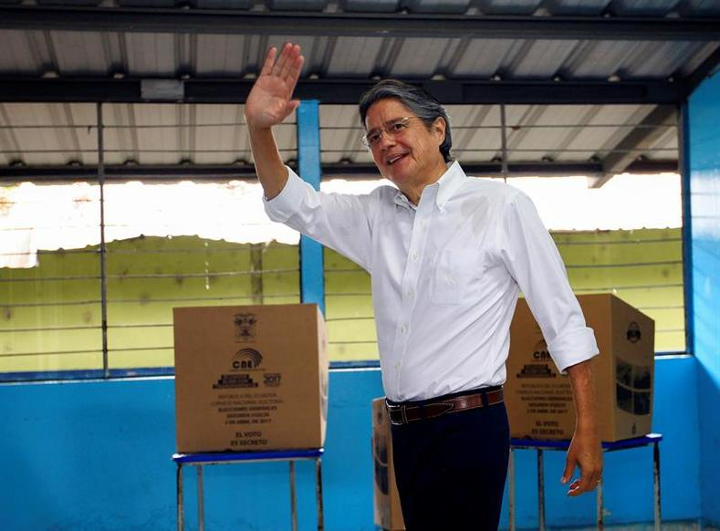 "Guillermo Lasso casts his ballot in Guayaquil, calling for peaceful voting in an election he described as ""crucial."""