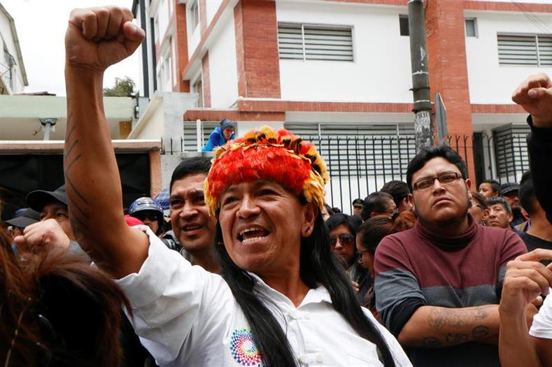 Supporters of governing party candidate Lenin Moreno shout slogans as he casts his vote in Quito.