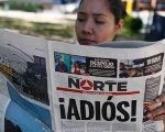 A woman reads the latest edition of Juarez's Norte newspaper, now set to close, in Chihuahua, Mexico, April 2, 2017.