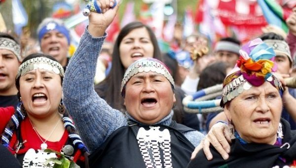 Mapuche women take part in a resistance march in Santiago, Chile Oct. 12, 2015.