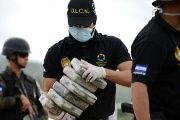 Anti-narcotics and military police officers prepare everything for the incineration of more than 200 kilos of cocaine seized in southern Honduras.