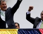 Ecuador's President Rafael Correa and president-elect Lenin Moreno greet supporters from the government palace's balcony during a change of guard ceremony in Quito.