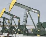 Pumpjacks taken out of production temporarily stand idle at a Hess site while new wells are fracked near Williston.