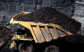 Haul trucks move coal as seen during a tour of Peabody Energy