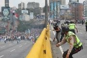 Protestors hurl rocks at police officers in Altamira, Caracas.