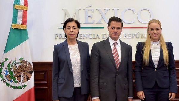 Mexican President Enrique Peña Nieto with Venezuelan opposition activist Lilian Tintori, right, April 6, 2017.