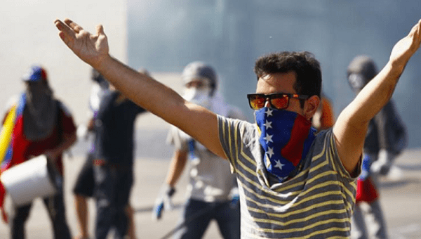 A Venezuelan opposition protester yells at police in Caracas.