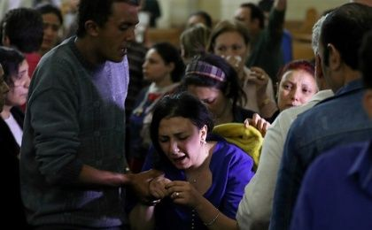 A relative of a victim reacts inside the Coptic church that was bombed in Tanta, Egypt, April 9, 2017.