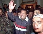 Chavez is surrounded by supporters upon his return to the presidential palace after a coup attempt on April 14, 2002.