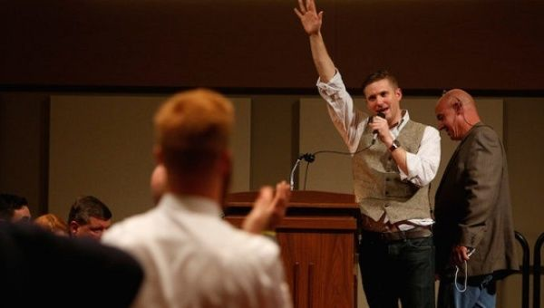 Richard Spencer does a Nazi salute at a white nationalist rally celebrating Donald Trump
