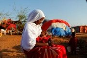 Zeinab, 14, sits as she holds her nephew at a camp for internally displaced people from drought-hit areas in Dollow, Somalia.