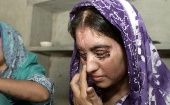 Sakeena (L), suffered burns to 70 percent of her body when her husband threw acid on her.