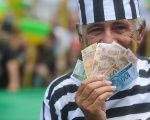 A demonstrator protests against corruption in Brazil, in Brasilia, Oct. 12, 2011.