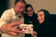 Chinese artist Ai Weiwei takes a selfie with women at the Islamic Art Museum in Doha, Qatar, April 11, 2017.