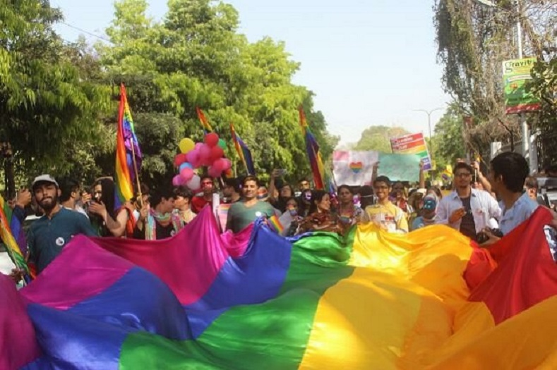 People hold the rainbow flag as they marched from Sikanderbagh Crossing to Gandhi Park at Hazratganj.
