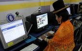 A woman in Bolivia uses free open-source software, which the World Wide Web Consortium is looking to curb.